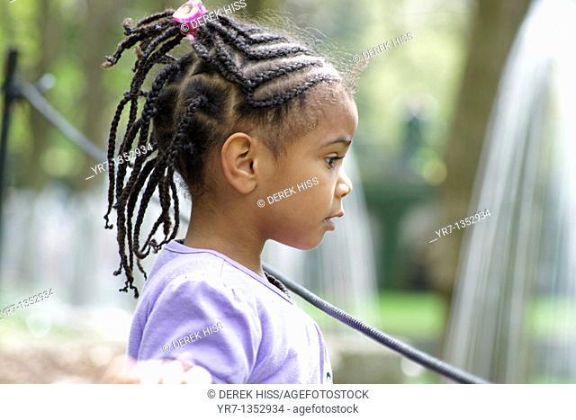 Young girl watching water fountain
