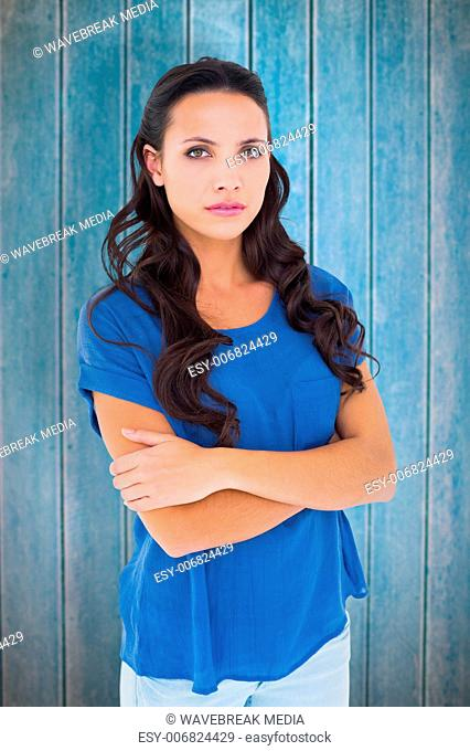 Composite image of angry brunette frowning at camera