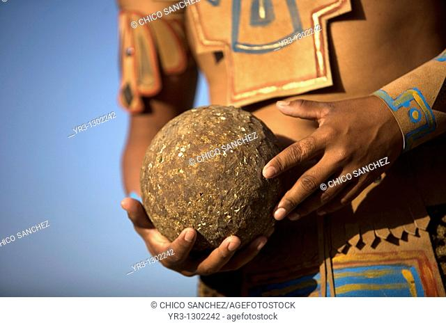 A Mayan ball player holds up the ball made of hule, natural rubber, in Chapab village in Yucatan state in Mexico's Yucatan peninsula, June 14, 2009