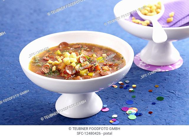 Pepper soup with sausage slices and pepper croutons