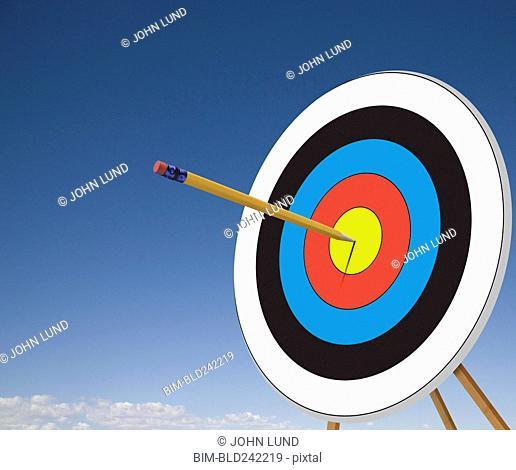 Pencil stuck in target bullseye