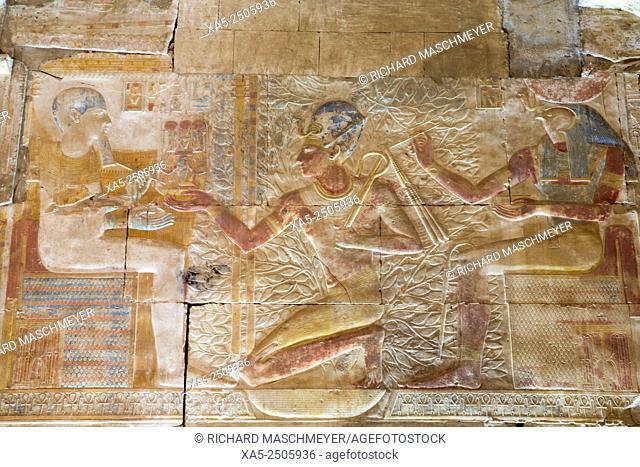 Bas-relief of Pharaoh Seti I (center), God Horus (right), Temple of Seti I, Abydos, Egypt
