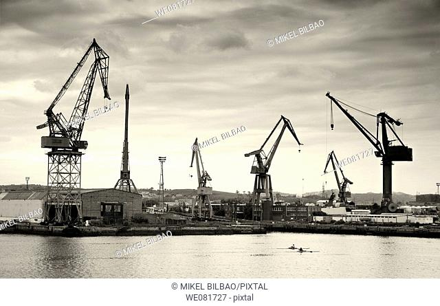 Cranes in a shipyard in black and white, Santander, Cantabria, Spain