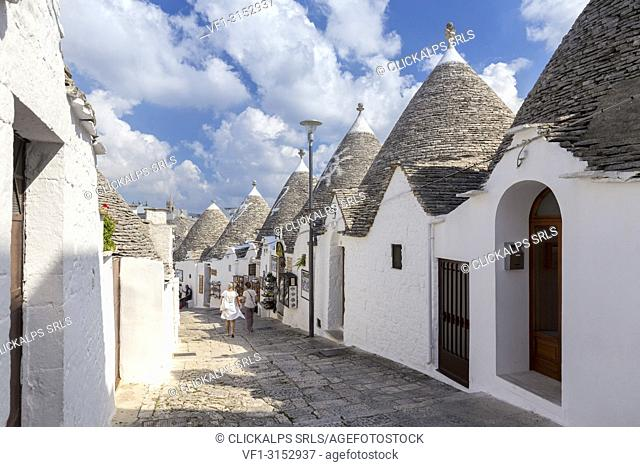 View of the typical Trulli huts and the alleys of the old village of Alberobello. Province of Bari, Apulia, Italy, Europe