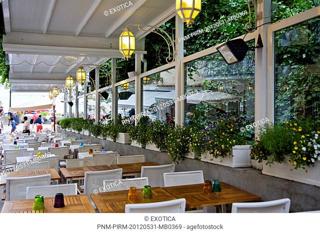 Empty tables and chairs in a restaurant, Positano, Amalfi, Province of Salerno, Campania, Italy