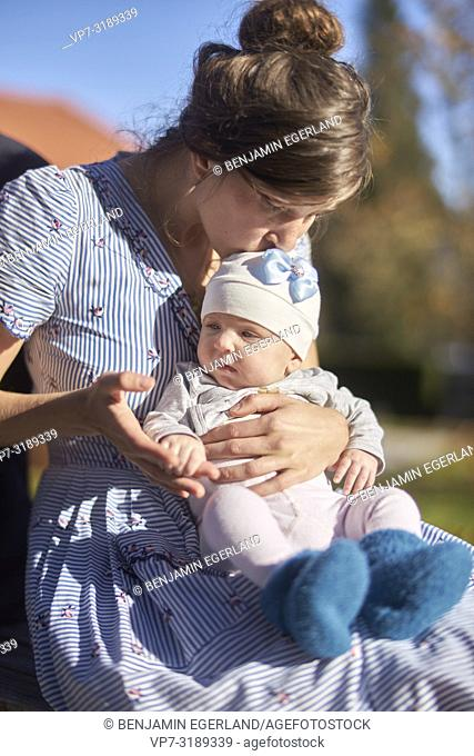 mother with baby outdoors, in Starnberg, Bavaria, Germany