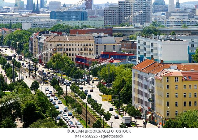 Berlin overview looking down at a busy street with trams and traffic