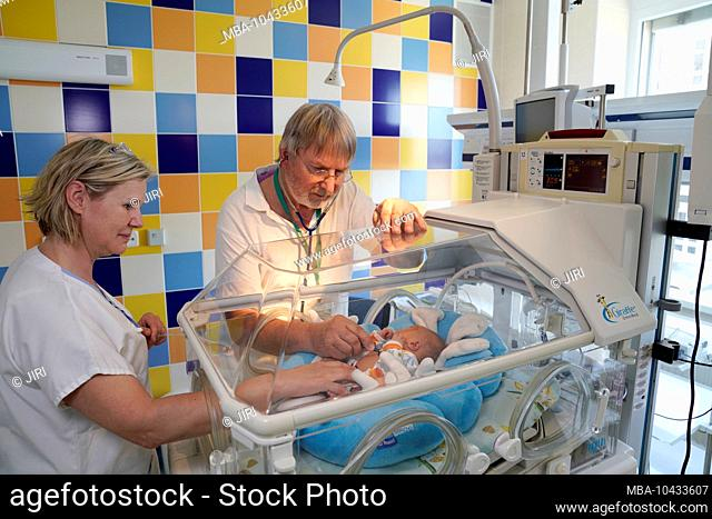 Doctor and nurse during an examination, intensive care unit for newborns, Karlovy Vary, Czech Republic