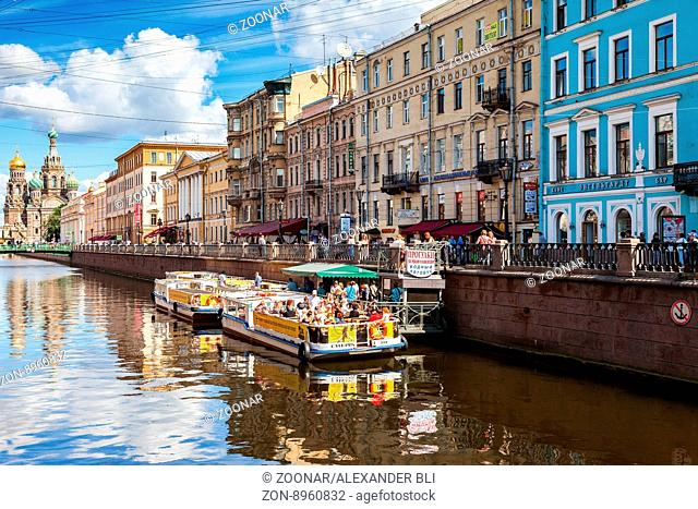 SAINT-PETERSBURG, RUSSIA - AUGUST 5, 2015: River cruise passenger boats moored on Griboedov channel in the historic city in sunny day
