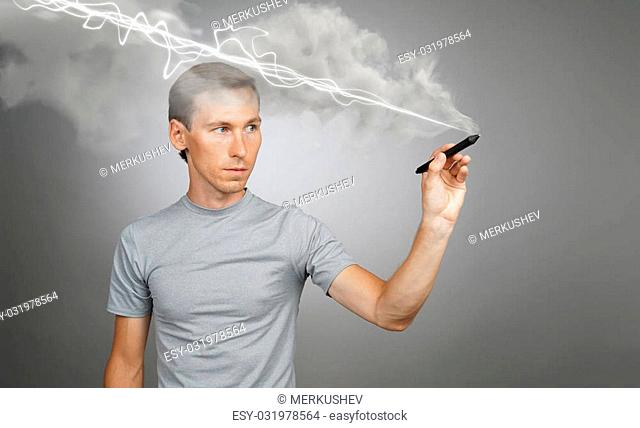 Young man making magic effect - flash lightning. The concept of copywriting or writing