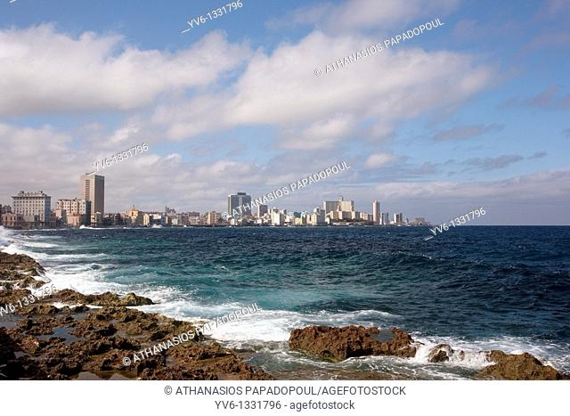 Landscape photograph of the Vedado area with tall buildings and skyscrapers by the sea shoot on a bright day with blue sky and white clouds, VEDADO, HAVANA