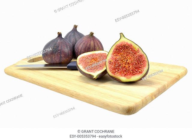 Fig fruit on wooden board