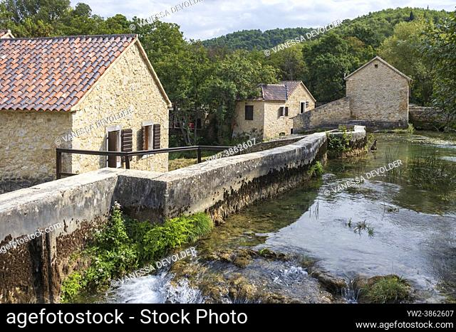 Old houses and museum near river in Krka National Park. Location: Sibenik-Knin County, Croatia, Europe