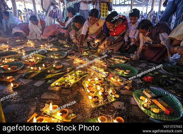 Hajo, India - November 2020: Women making offerings at the Hayagriva Madhava Temple in Hajo on November 12, 2020 in Assam, India