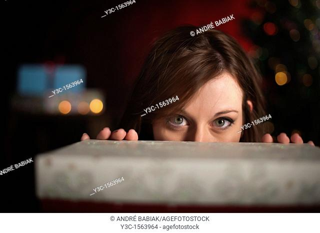Woman behind gift box at Christmas time