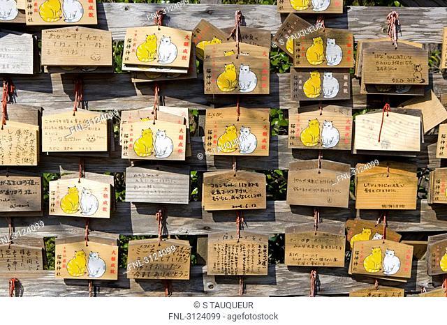 Strips of paper hanging on wooden planks, Kagoshima, Japan