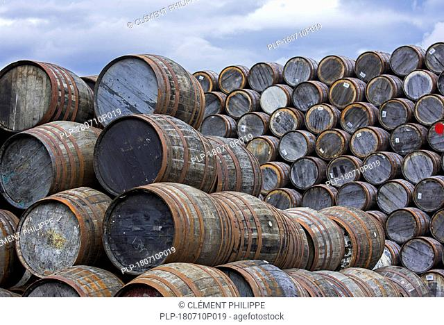 Huge stacks of discarded whisky casks / barrels at Speyside Cooperage, Craigellachie, Aberlour, Banffshire, Grampian, Scotland, UK