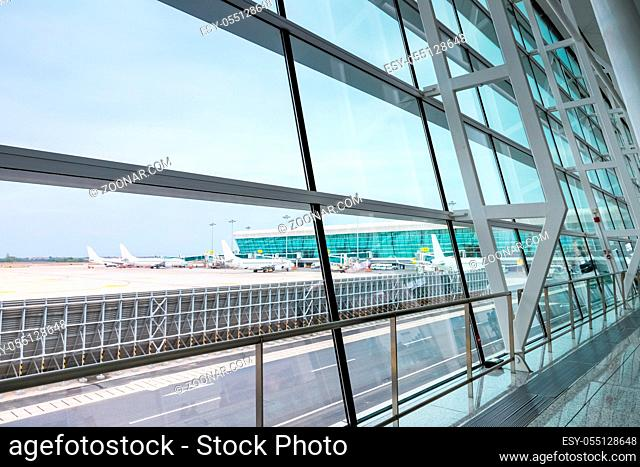 modern airport scene, view of outside the terminal window