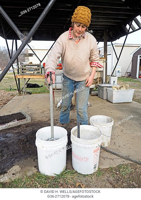 Small-scale farmer preparing seedlings on an artisanal organic farm in Johnston, Rhode Island, USA
