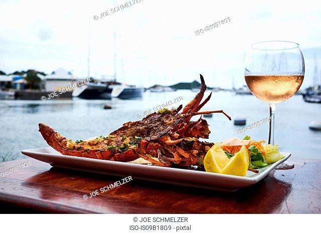 Light seafood dish, glass of rose wine