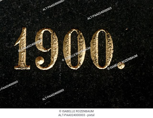 '1900' text, embossed in gold