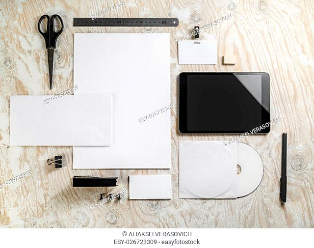 Blank corporate identityBlank stationeryon light wooden background. For design presentations and portfolios
