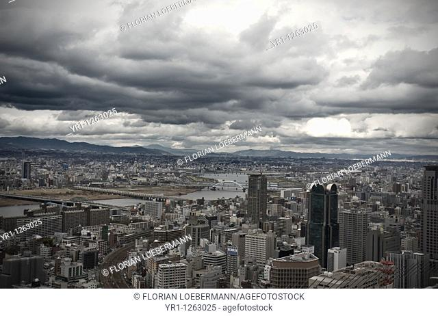 Stormy clouds over the city of Osaka, Japan. Bridges are crossing river yodo