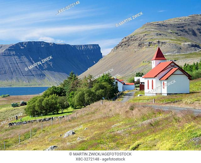 Myrafell and church. Landscape at fjord Dyrafjoerdur. The remote Westfjords (Vestfirdir) in north west Iceland. Europe, Scandinavia, Iceland