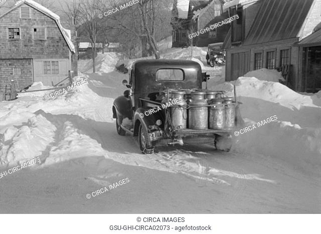 Farmer Delivering Milk Cans in Truck, near Woodstock, Vermont, USA, Marion Post Wolcott for Farm Security Administration, March 1940