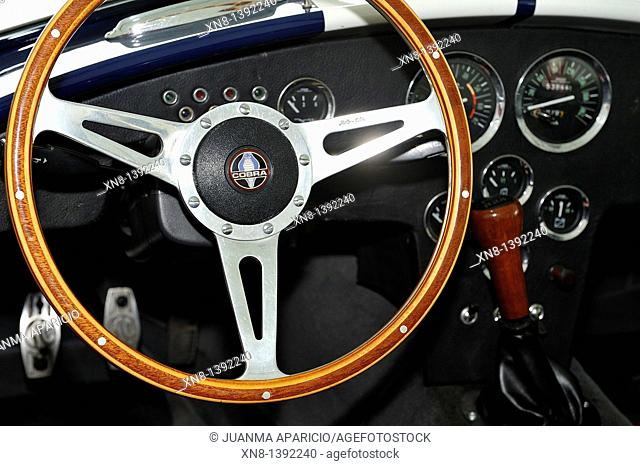 View the steering wheel and interior of a replica AC Cobra