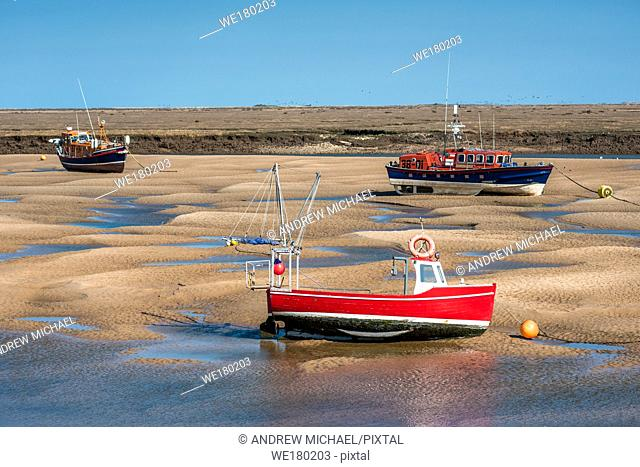 Lifeboard boats marooned on sandbanks at low tide on East Fleet river estuary at Wells next the sea, North Norfolk coast, East Anglia, England, UK