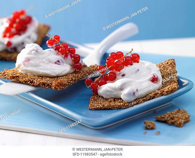 Redcurrant quark on amaranth crackers