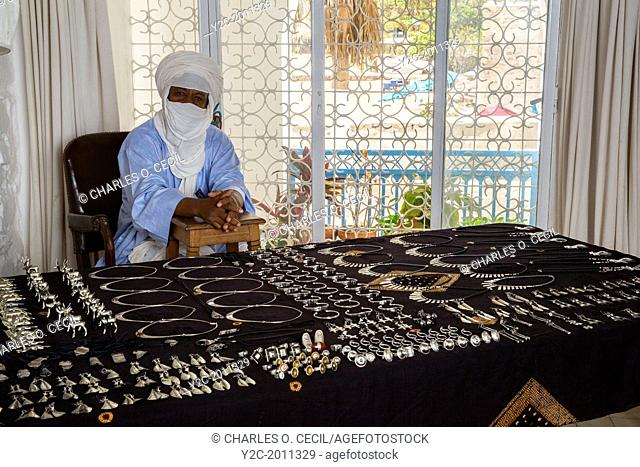 Silversmith Adam Zidia, a Tuareg from Agadez, Niger, offering Silver Jewelry at Biannual Arts Festival, Goree Island, Senegal