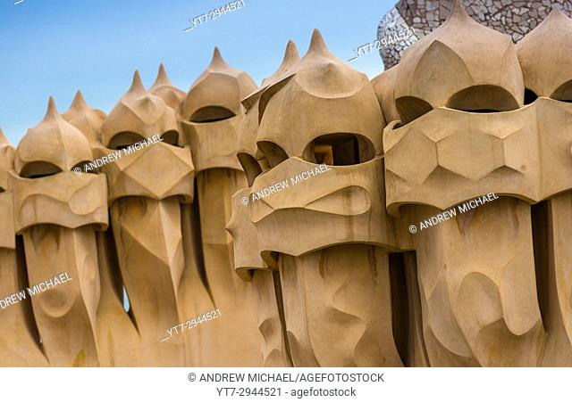 Barcelona, Guadi's The Pedrera (Casa Mila) on the roof with its unusual chimneys, Catalonia, Spain