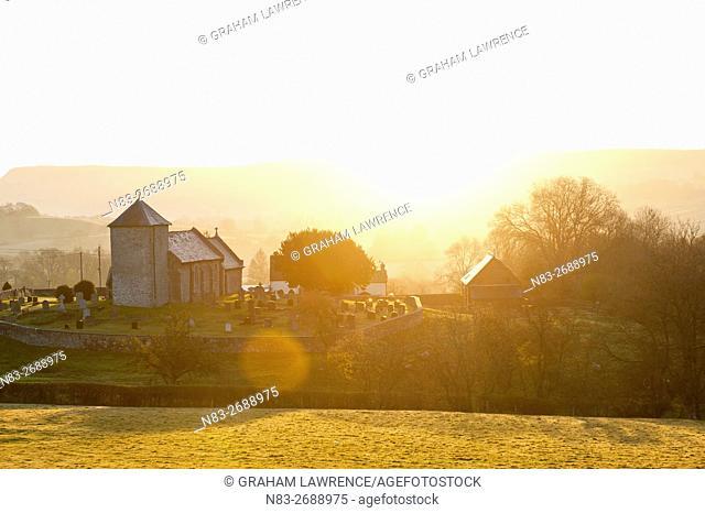A view at sunrise of Saint David's Church in the tiny hamlet of Llnddewi'r Cwm, Powys, Wales, UK