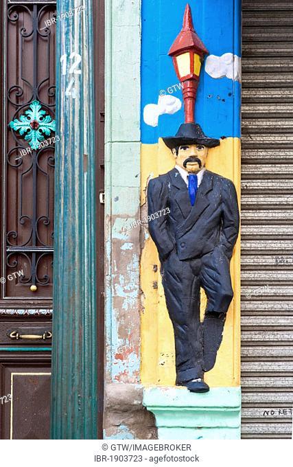 Facade relief of a man, El Caminito street, La Boca district, Buenos Aires, Argentina, South America