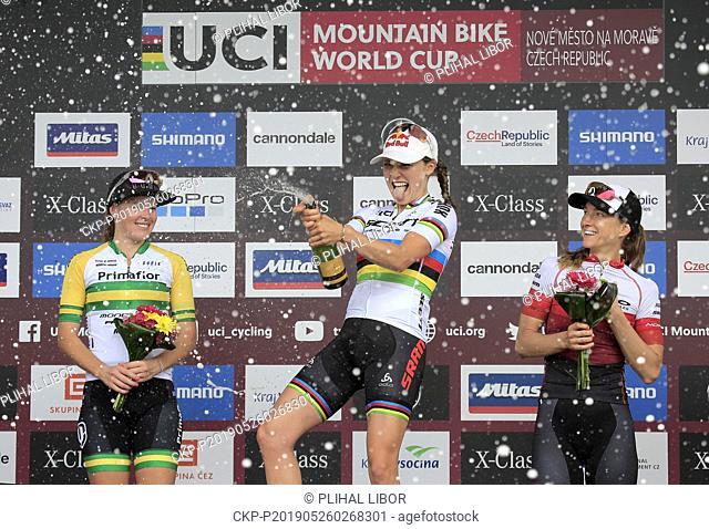 From left silver ELLEN MCCONNELL of Australia, winner KATE COURTNEY of USA, bronze HALEY SMITH of Canada on the stage after the women elite Cross Country...